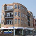 Slim profile grey aluminium windows, doors, curtain walling and shopfronts installed in Woodford Green by DWL
