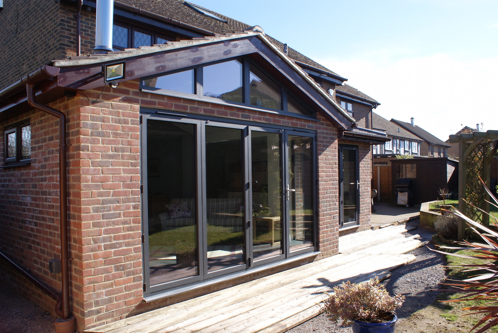 Triangle Folding Doors : Sensations grey bi folding doors and window in grove green