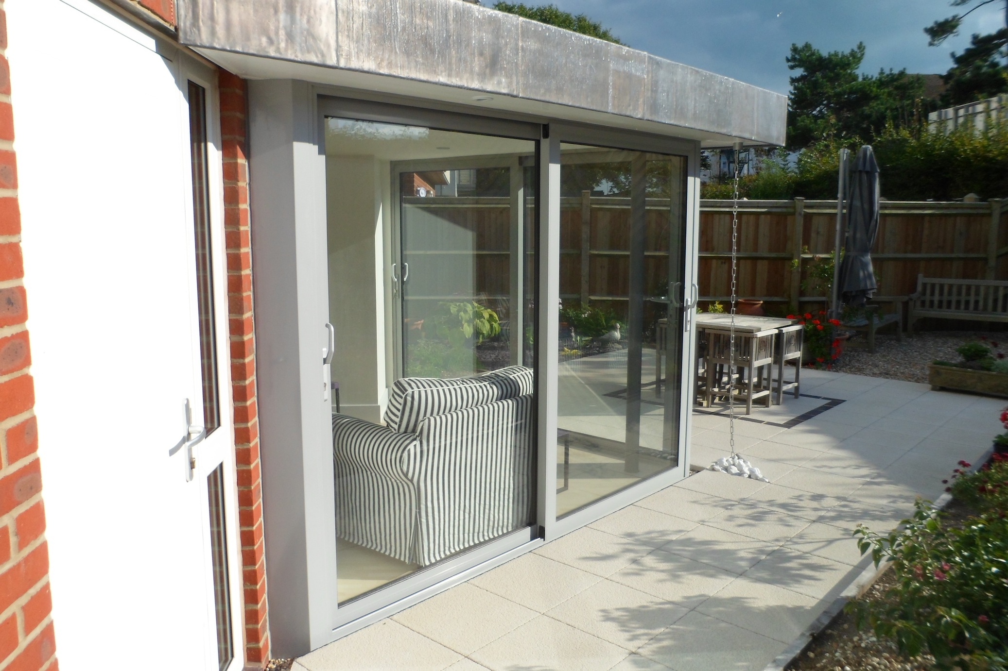 Aluminium sliding doors dwl windows doors conservatories for Windows doors and conservatories