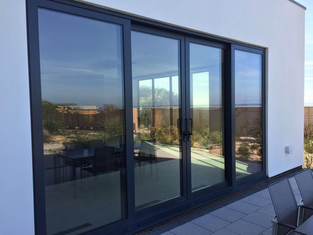 Aluminium sliding doors dwl windows doors conservatories for Patio doors folding sliding