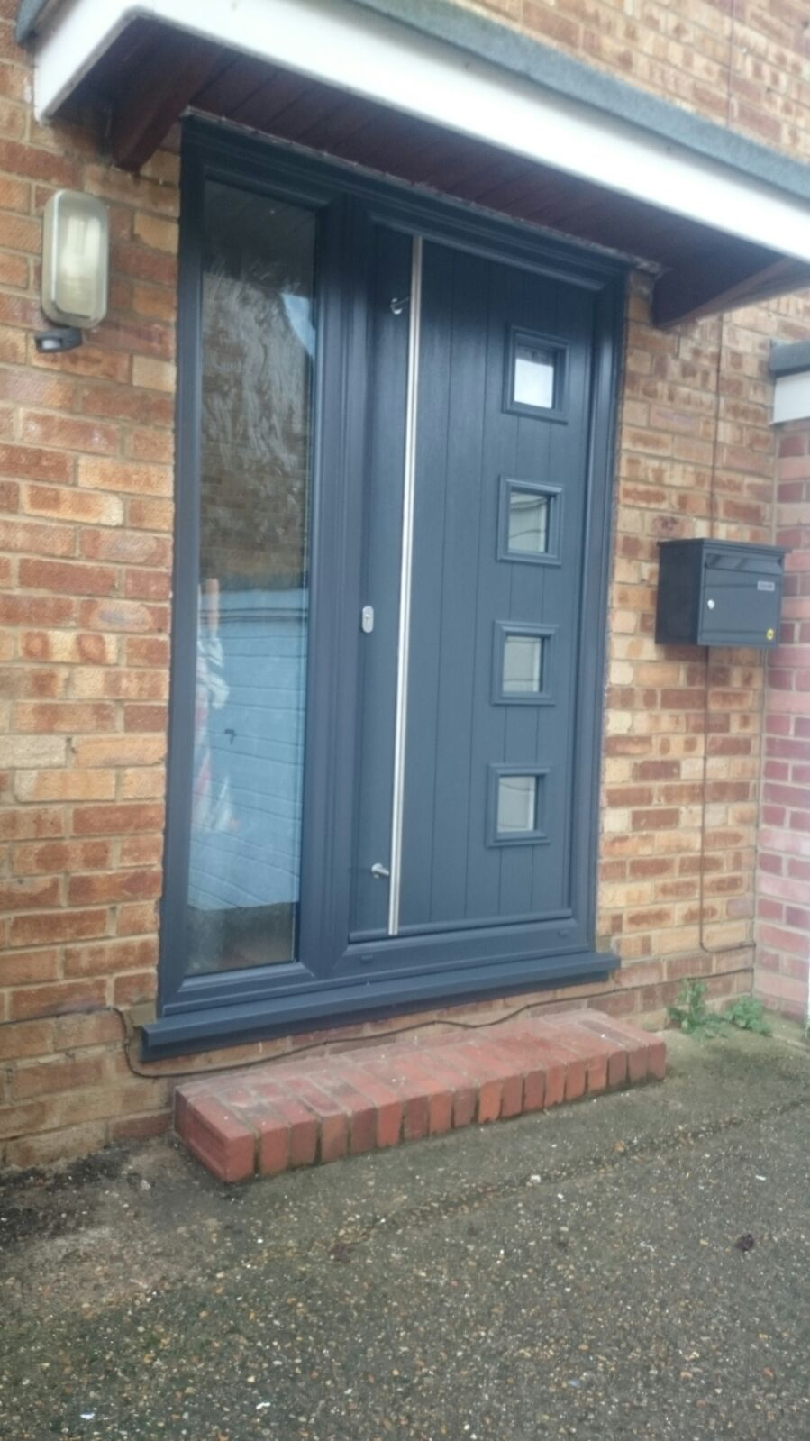 Aluminium white bifolding doors and solidor installed dwl for Doors for front door