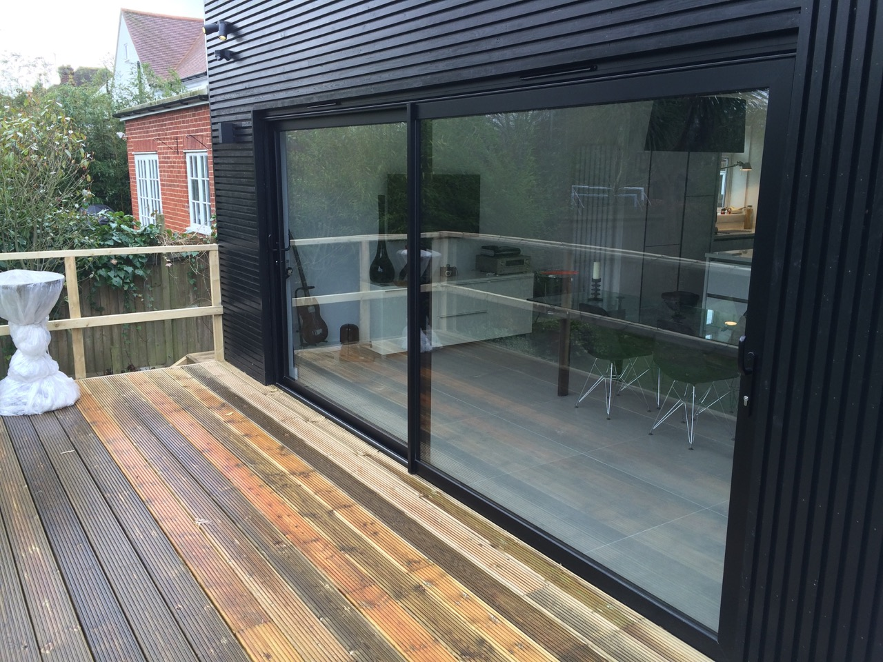 Bi fold doors or sliding doors the pros and cons dwl for Black sliding glass doors