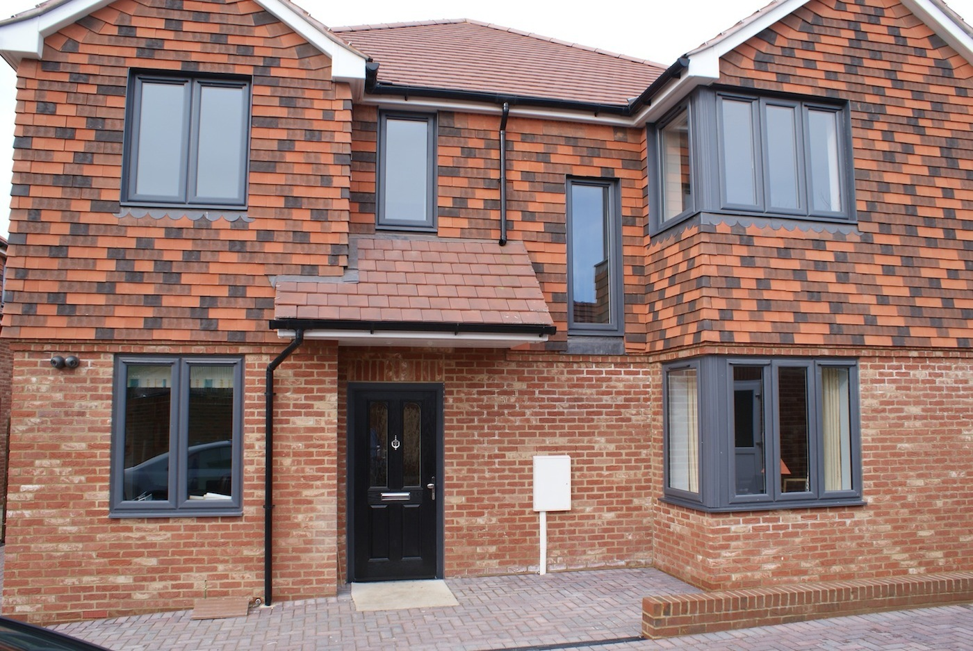 Upvc grey windows and black composite door installed dwl for Composite windows