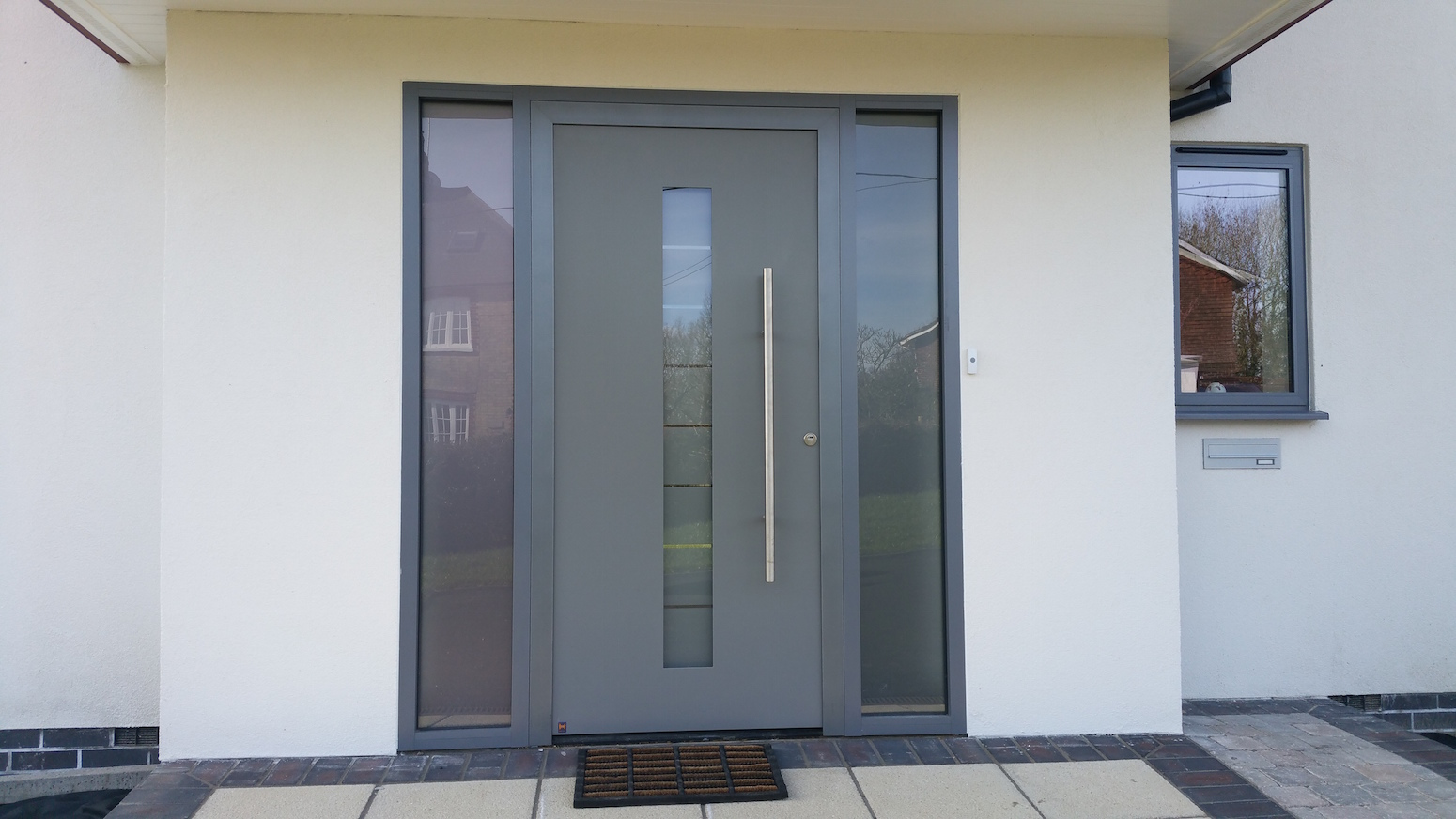 Hormann entrance door in the South East & Aluminium Feature entrance Doors | DWL Windows