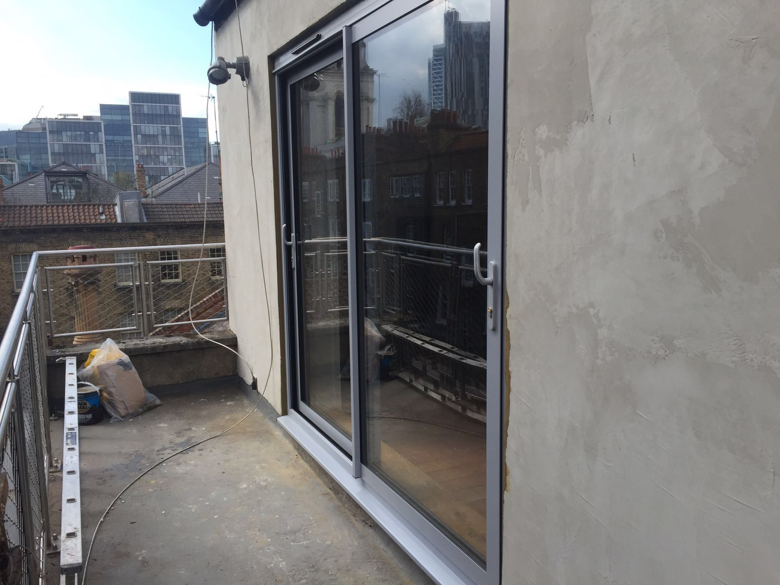 Thin frame aluminium patio doors installation london dwl for Aluminium patio doors