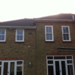 uPVC white woodgrain vertical sliding windows into Essex home by DWL