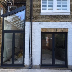 grey aluminium doors and Juliette balcony