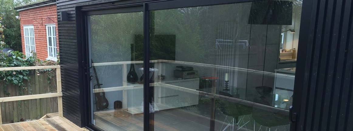 Black aluminium sliding patio doors and window