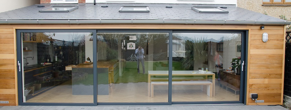 Grey aluminium sliding doors and grey windows
